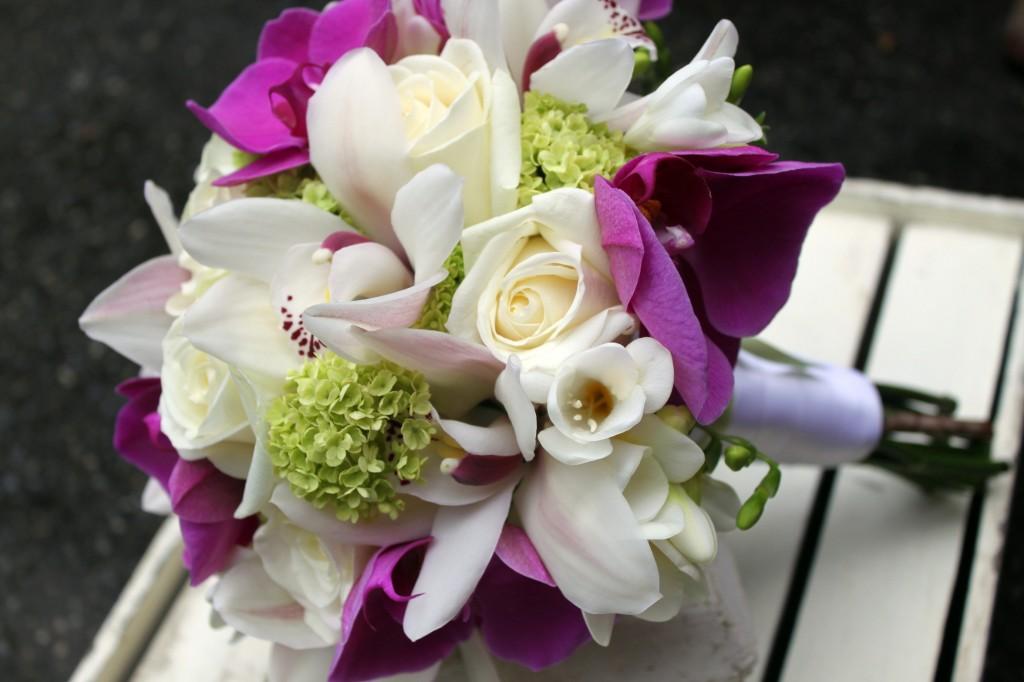 Phalaeonopsis, freesia, viburnum, cymbidium and roses bridal bouquet