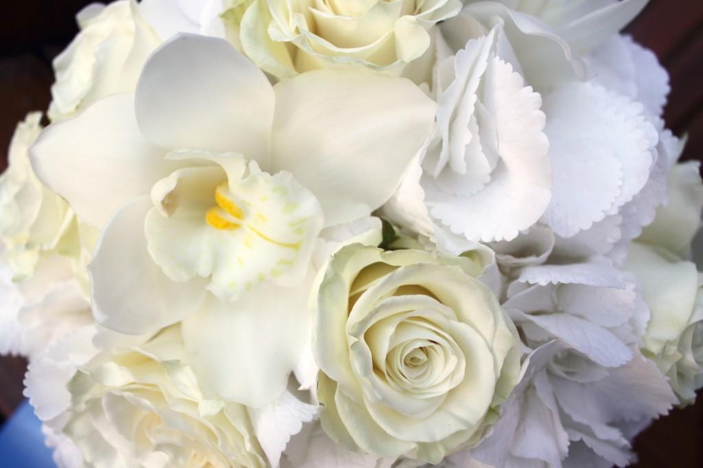 Cymbidium orchids roses and hydrangea