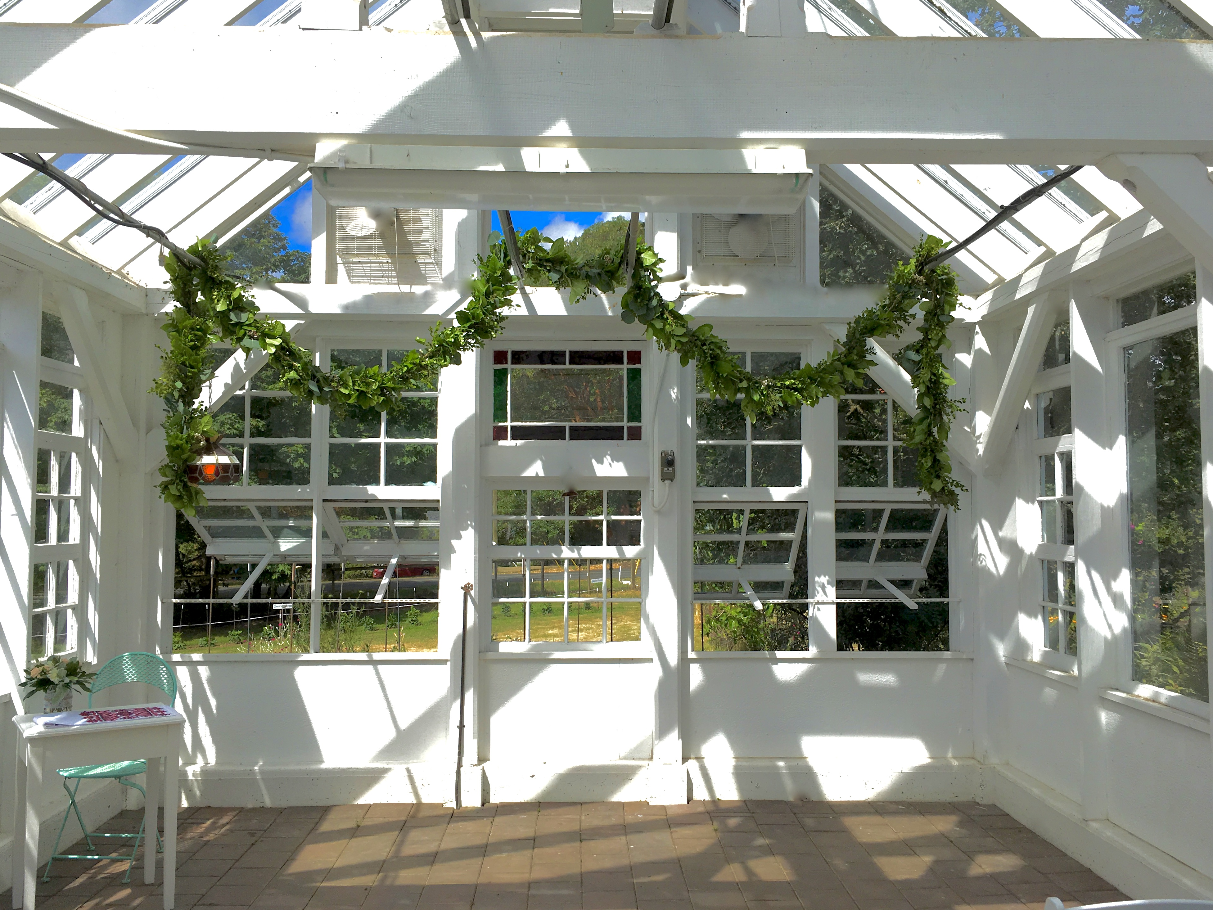 Starling Lane's greenhouse decorated with fresh garland